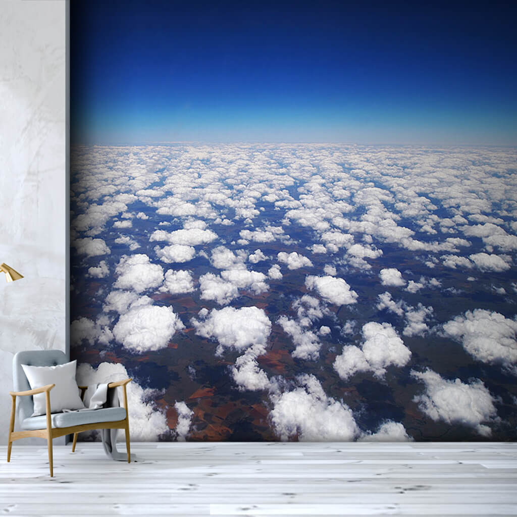 Earth among white clouds from the atmosphere wall mural