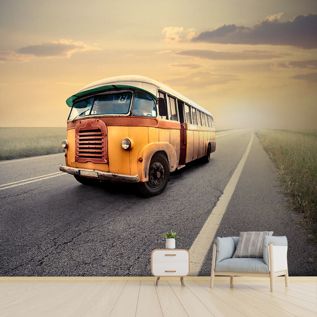 Old yellow vintage bus on the foggy prairie road wall mural