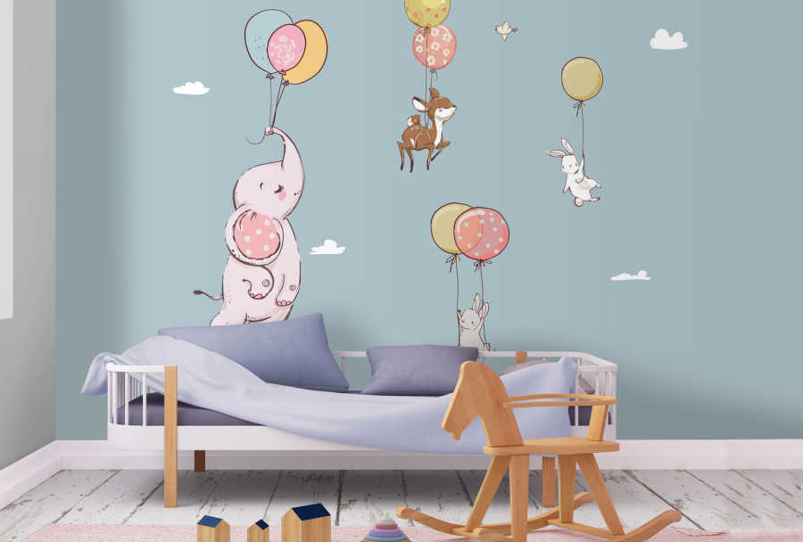 Elephant gazelle and rabbits flying with balloons wall mural