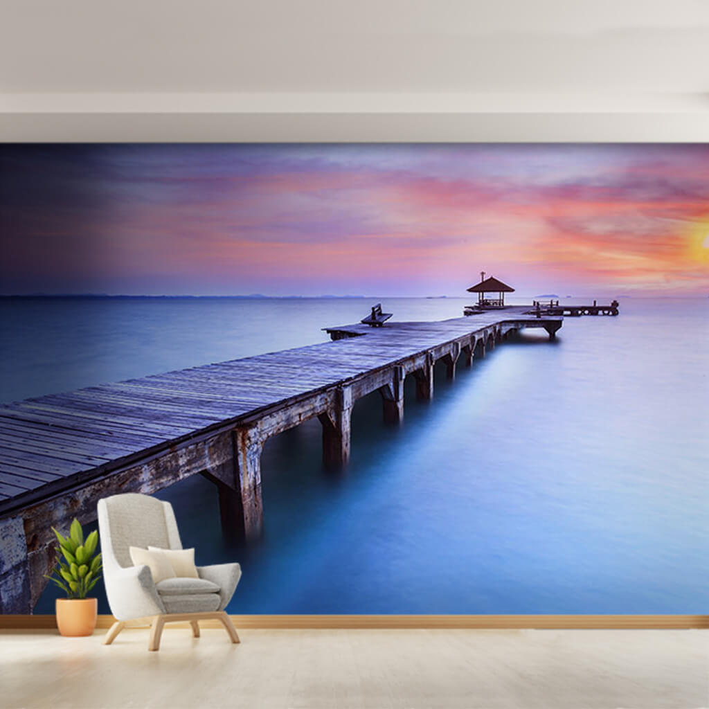 Bower on wooden jetty extending into the calm sea wall mural