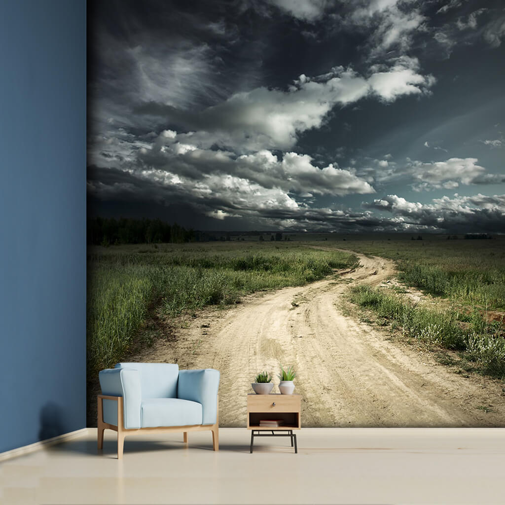 Bulutlu gökyüzü altında platoda uzanan toprak yol duvar kağıdı